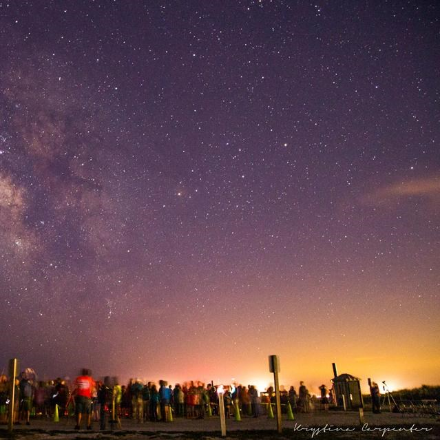 Visitors viewing the night sky over Assateague Island